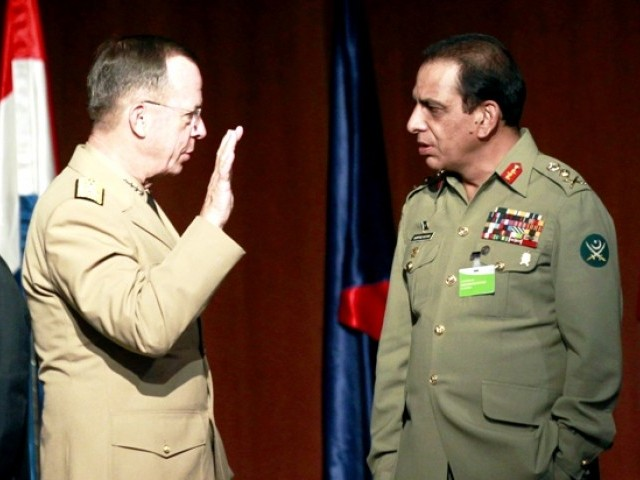 Pakistan's Army Chief General Ashfaq Kayani (R) listens to U.S. Admiral Mike Mullen at the start of the NATO MC conference in Seville September 16, 2011. PHOTO: REUTERS