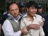 An ethnic Hazara Shia is comforted by his relative after he arrived at the local hospital in Quetta, to find a family member shot dead, September 20, 2011.PHOTO: REUTERS