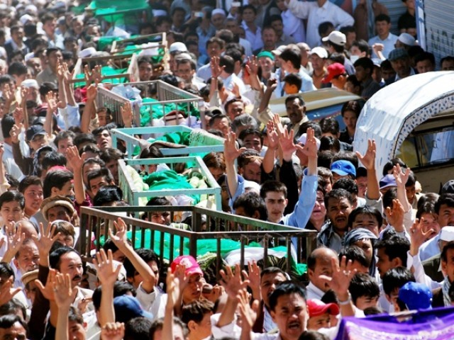 Shia Muslims shout slogans as they carry coffins of their community members during a funeral ceremony in Quetta on September 21, 2011. PHOTO: AFP