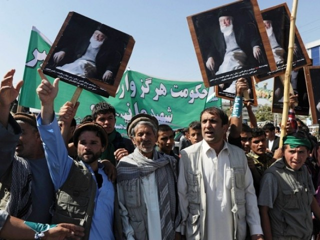 Supporters of the slain former Afghan president Burhanuddin Rabbani shout slogans and hold up his portrait during a protest against the Taliban and Pakistan in Kabul on September 27, 2011. PHOTO: AFP