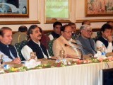 Prime Minister Yousuf Raza Gilani (3L) flanked by PML-N leader Nawaz Sharif (2L), and other politicians Imran Khan (R), Asfandyar Wali Khan (2R) and Chaudhry Shujaat (3R). PHOTO: AFP