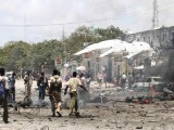 Security personnel cordon of the blast site in Mogadishu on October 4, 2011. PHOTO: REUTERS