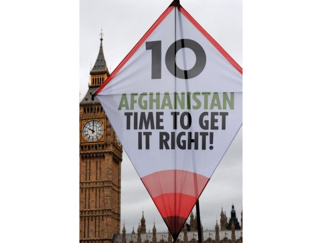 (Earthquake 2005) Demonstrators fly a giant kite near the House of Commons in central London, as they mark the anniversary of military intervention in Afghanistan. PHOTO: AFP