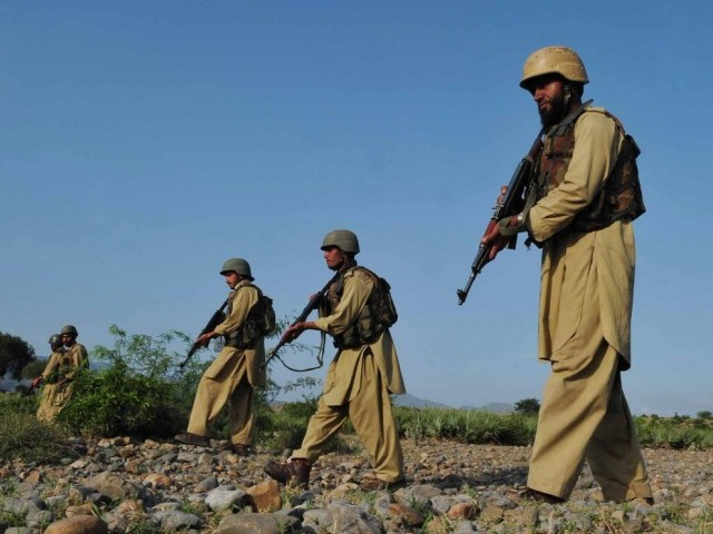 Pakistani soldiers killed 30 Afghan militants who had crossed the border to attack the army. PHOTO: AFP/FILE