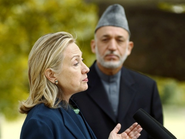 US Secretary of State Hillary Clinton talks near Afghan President Hamid Karzai during a joint news conference after their meeting at the Presidential Palace in Kabul October 20, 2011. PHOTO: REUTERS