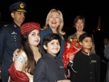 Pakistani children welcome US Secretary of State Hillary Clinton upon her arrival in Islamabad October 20, 2011. PHOTO: REUTERS