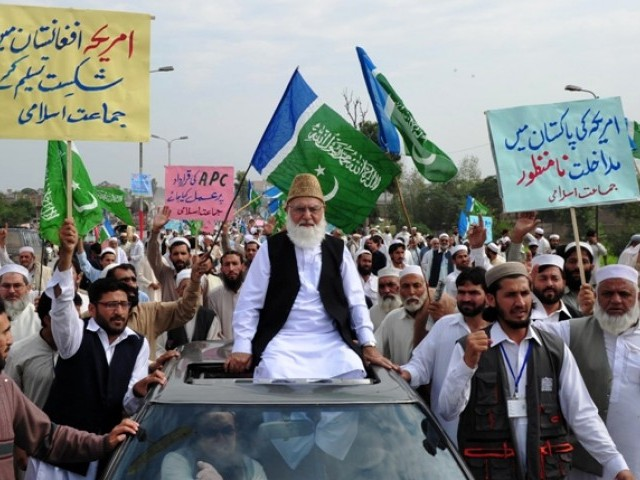 Qazi Hussain Ahmed, leader of Jamaat-e-Islami Pakistan, leads a rally  in Peshawar on October 23, 2011. PHOTO: AFP