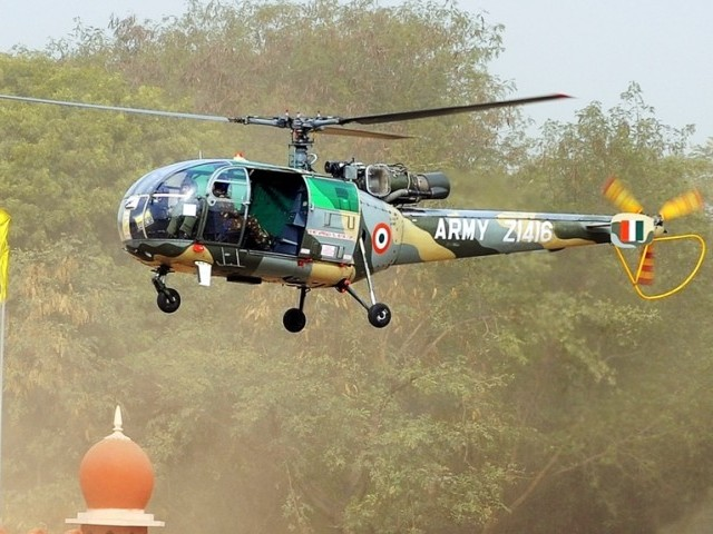 In this photograph taken on January 28, 2010, an Indian Army Chetak helicopter, a licence-built version of the French Alouette III and successor of the smaller Cheetah utility helicopter, makes a fly-past during a National Cadet Corps (NCC) parade in New Delhi. PHOTO: AFP