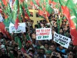 Supporters of the Pakistani politician Imran Khan and chief of Tehreek-e-Insaf (Movement for Justice) party, attend a protest rally in Islamabad on October 28, 2011 against the US drone attacks in Pakistani tribal region. PHOTO : AFP