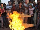 Supporters of the Pakistani politician Imran Khan and chief of Tehreek-e-Insaf (Movement for Justice) party, burn a replica drone as they shout slogans during protest rally in Islamabad on October 28, 2011 against the US drone attacks in Pakistani tribal regions. PHOTO: AFP