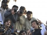 Pakistani politician and chief of Tehreek-e-Insaf (Movement for Justice) party, Imran Khan (R) addresses the crowd during a protest rally in Islamabad on October 28, 2011 against the US drone attacks in Pakistani tribal region. PHOTO : AFP