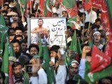 Supporters of Pakistani politician Imran Khan and chief of Tehreek-e-Insaf (Movement for Justice) party, attend a protest rally in Islamabad on October 28, 2011 against the US drone attacks in Pakistani tribal region. PHOTO : AFP