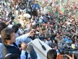 PTI Chairman Imran Khan speaks to a protest rally against drone strikes at Prade Avenue. PHOTO: INP