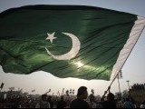 A supporter of political party Pakistan Tehreek-e- Insaf (PTI) waves the national flag during an anti-government rally in Lahore October 30, 2011. PHOTO : REUTERS