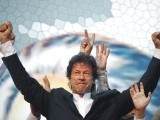 Imran Khan, Pakistani cricketer turned politician, gestures after arriving to lead the Pakistan Tehreek-e- Insaf (PTI) rally in Lahore October 30, 2011.  PHOTO: REUTERS