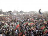 A sea of PTI supporters at the Minar e Pakistan bagh in Lahore. Camermen on cranes shoot the proceedings. PHOTO : INP