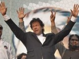 PTI Chairman Imran Khan responding to his supporters at the rally in Lahore on October 30, 2011. PHOTO : NNI