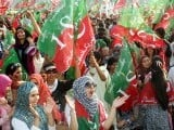PTI supporters sloganeering at the rally in Lahore on October 30, 2011. PHOTO : PPI