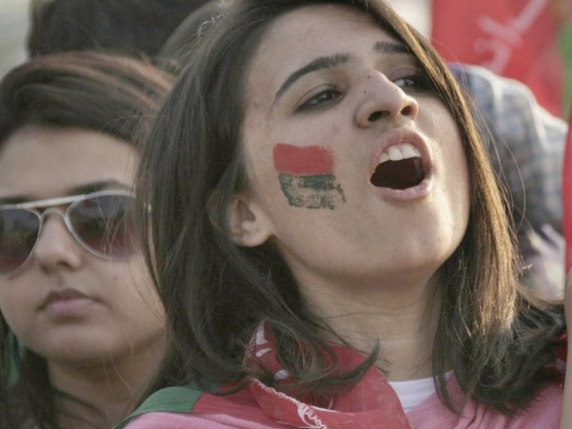 PTI supporters sloganeering at the rally in Lahore on October 30, 2011. PHOTO : NNI
