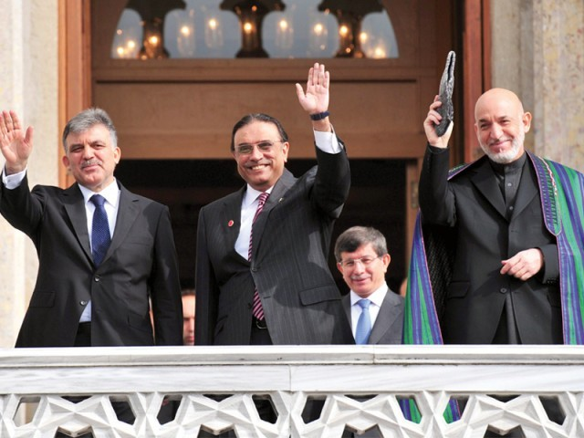 Turkish President Abdullah Gul (L), President Asif Ali Zardari (C) and Afghan President Hamid Karzai (R) wave from Ciragan Palace after their meeting in Istanbul. PHOTO: AFP