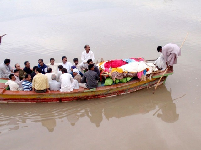 Bodies of the murdered Hindu victims are being taken near the Sadhu Bela Temple in Sukkur. PHOTO: SARFARAZ MEMON