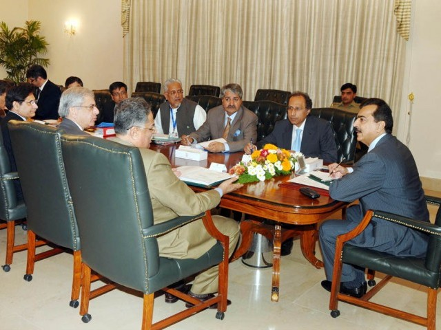 Prime MInister Yousaf Raza Gilani chairing a meeting on 3G licence and Grey Traffic at the PM house on Wednesday. PHOTO: PID