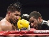 Lamont Peterson of the U.S. lands a shot on Amir Khan (L) of Britain during the ninth round of their WBA super lightweight and IBF Junior welterweight title fight in Washington, December 10, 2011. PHOTO: AFP