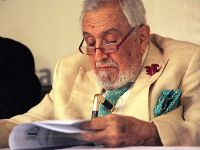 The columnist and philanthropist, Ardeshir Cowasjee, was presented the 11th Jinnah Award at the head office of the Oxford University Press on Tuesday. He is seen here going through a memento presented to him, a leather-bound compilation of his work published in Dawn over the last ten years. PHOTO: NEFER SEHGAL/EXPRESS