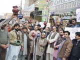 PML-N workers rage against Hashmi leaving, while PTI workers rejoice at his arrival into the party. PHOTO: DAILY EXPRESS