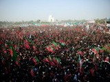 Supporters of Pakistani cricketer turned politician Imran Khan gather for a public rally in Karachi on December 25, 2011. PHOTO: AFP
