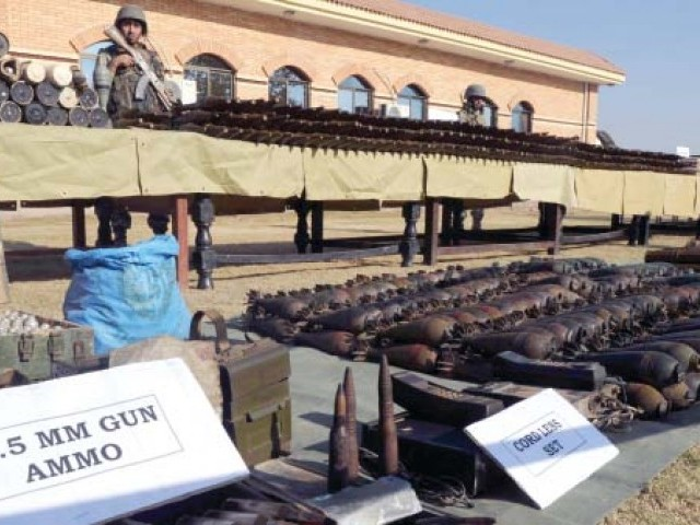 The paramilitary Frontier Corps displays the weapons seized in Bara. PHOTO: AFP