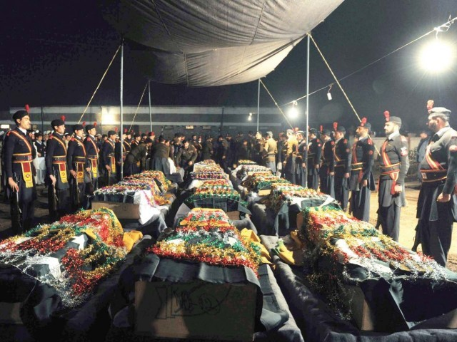 Frontier Constabulary soldiers prepare for funeral prayers of their comrades during a ceremony in Peshawar. PHOTO: AFP
