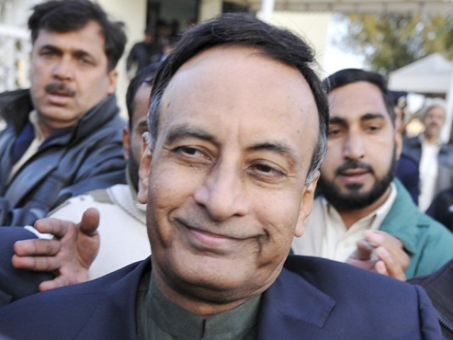 Husain Haqqani exits the Supreme Court after meeting his lawyer Asma Jehangir, in Haqqani's defence in the secret memo scandal case, in Islamabad on December 22, 2011. PHOTO: AFP/FILE