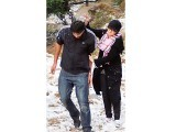 Visitors play in the snow at Pir Sohawa on Saturday. PHOTO:ONLINE