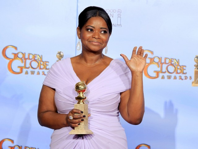 "Octavia Spencer holds the award for best performance by an actress in a supporting role in a motion picture - drama for ""The Help,"" backstage at the 69th annual Golden Globe Awards. PHOTO:REUTERS"
