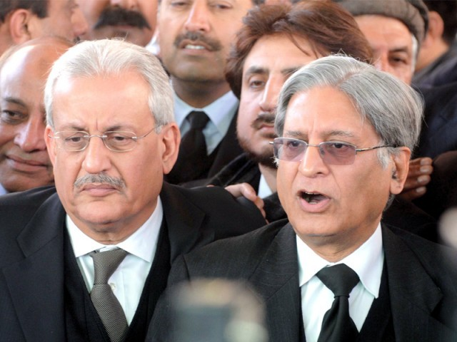 Prime Minister Yousaf Raza Gilani's counsel Aitzaz Ahsan, along with Senator Raza Rabbani, talks to reporters outside the Supreme Court. PHOTO: MOHAMMAD JAVED