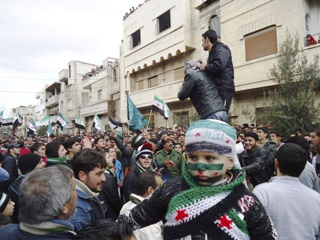 Demonstrators take part in a protest against Syria's President Bashar al-Assad in Baba Amro, near Homs, in this handout picture received January 22, 2012. PHOTO: REUTERS
