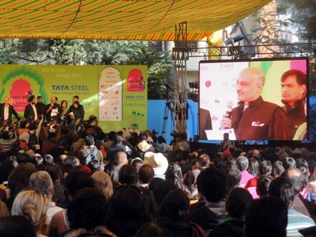 The owner of JLF's venue (on giant screen), announces the cancellation of Salman Rushdie's video link session. PHOTO: AFP
