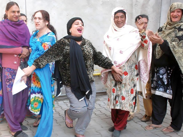Transgender community celebrates outside a NADRA office in Lahore. PHOTO: NNI