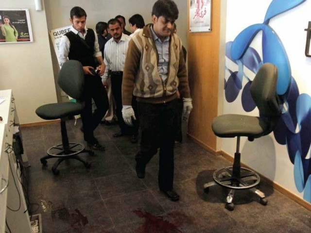 Armed men attacked a Telenor franchise near the Matric Board Office in North Nazimabad on Tuesday. PHOTO: EXPRESS