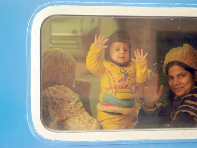 Passengers sit in a newly launched Pak Business Express train prior to departure from Lahore. PHOTO: AFP