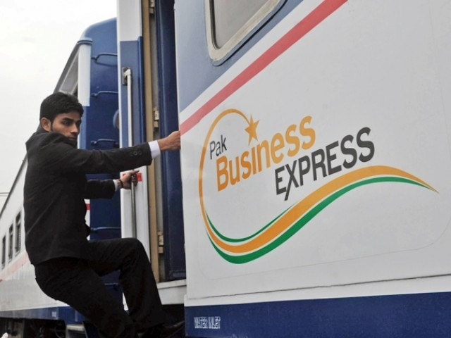 A passenger boards newly launched Pak Business Express train prior to departure in Lahore on February 3, 2012.  PHOTO: AFP