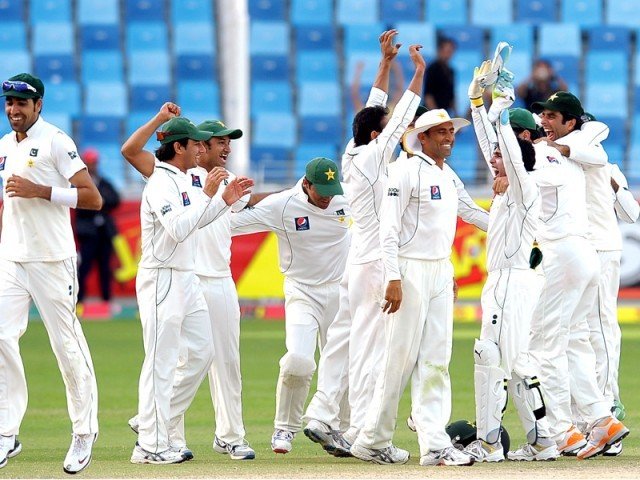 Celebrations after victory in the final Test match against England at the Dubai International Cricket Stadium. PHOTO: AFP