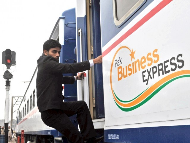 A passenger boards the newly-launched Pak Business Express train prior to departure in Lahore on February 3, 2012. PHOTO:AFP