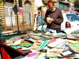 A man looks at books at a roadside book stall in Karachi. PHOTO: MOHAMMAD SAQIB/EXPRESS
