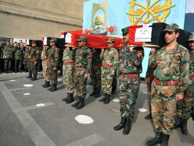 A picture released by the official Syrian Arab News Agency (SANA) shows Syrian security forces carrying the coffin of military personnel, who the agency said were killed in recent violence in the country, during their funeral outside the Tishrin military hospital in Damascus, on February 12, 2012. PHOTO: AFP