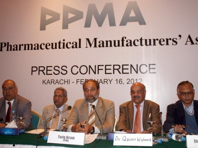 Acting Chairman Pakistan Pharmaceutical Manufactures Association, Tariq Akram addressing a press conference at a local hotel in Karachi.