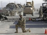 a-u-s-soldier-keeps-watch-at-the-site-of-an-explosion-in-kandahar