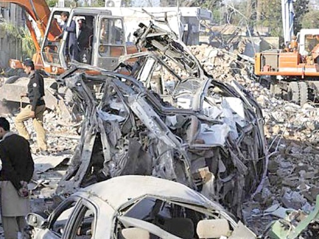 Vehicle lies mangled at the site of the blast last year. PHOTO: FILE