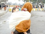 A woman carries her child in search of an operational bus stop (left) while children played with toy guns (centre) and dressed up like the dead (right). PHOTOS: MUHAMMAD JAVAID, MYRA IQBAL, EXPRESS